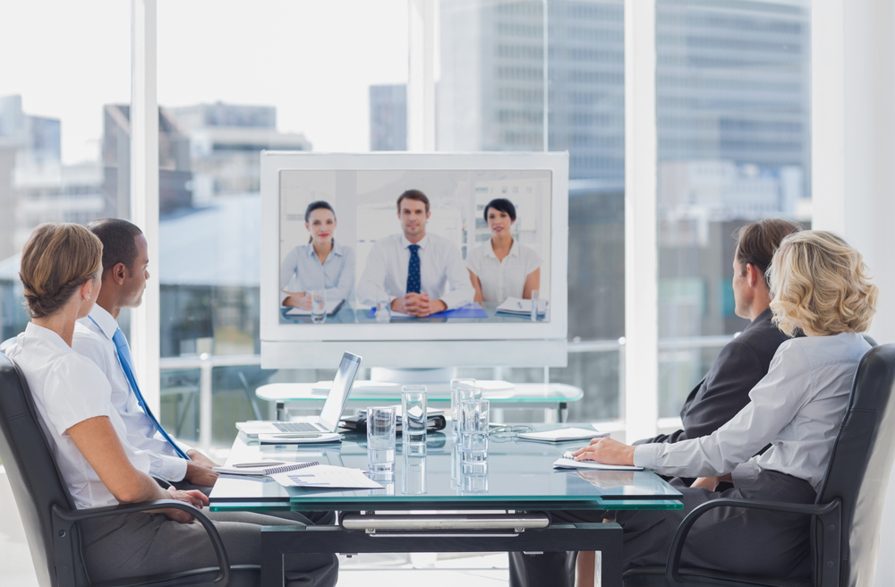 Video conference between businesses to communicate next steps.
