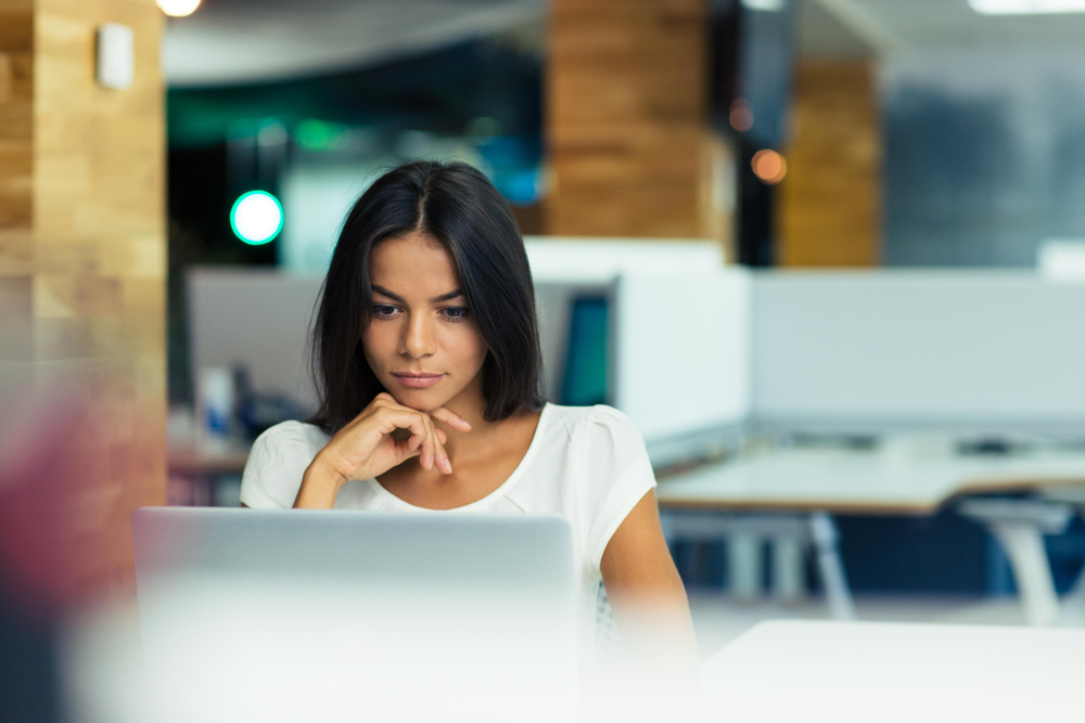 Businesswoman reviewing content marketing strategy on laptop
